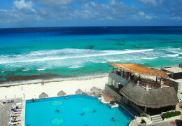 Photo of a beach and resort in Cancun, Mexico.