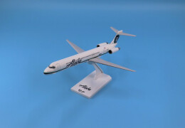 Photo of an Alaska MD-80 model plane with blue background.