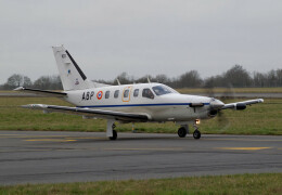 Photo of Socata TBM 700 sitting on the runway.