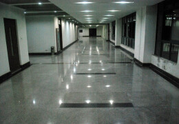 Photograph of an empty office lobby at night.